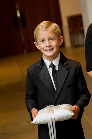 blond-ring-bearer-with-black-tie-and-braces