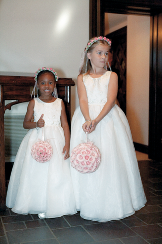 flower-girls-wearing-white-dresses-wearing-pink-flower-crowns-and-pink-flower-purses