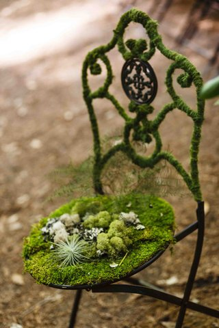 bistro-chair-covered-with-moss-at-forest-wedding-ceremony