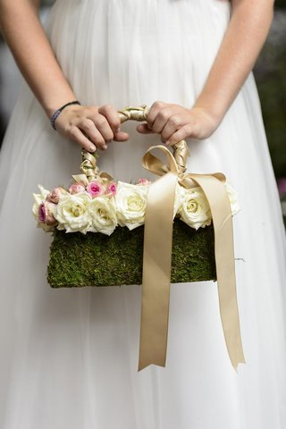 flower-girl-carrying-moss-covered-hand-bag