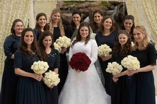 navy-bridesmaid-dresses-and-rose-bouquets