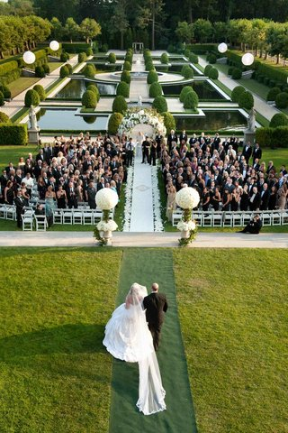 wedding-ceremony-in-the-landscaped-garden-of-oheka-castle