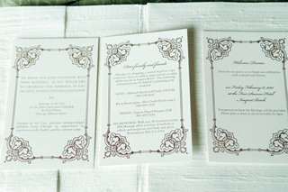 white-stationery-with-scroll-border-and-wedding-weekend-schedule