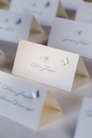 white-seating-card-with-grey-lettering-and-applique
