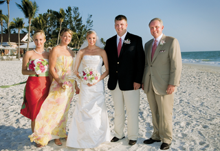 bride-and-family-pose-on-florida-beach