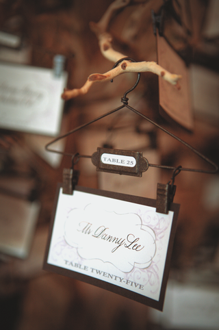 tiny-clothes-hanger-holding-place-card