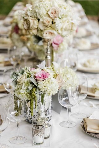 reception-centerpieces-filled-with-pale-flowers