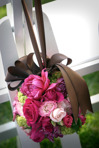 pink-and-green-flower-ball-hung-with-brown-ribbon