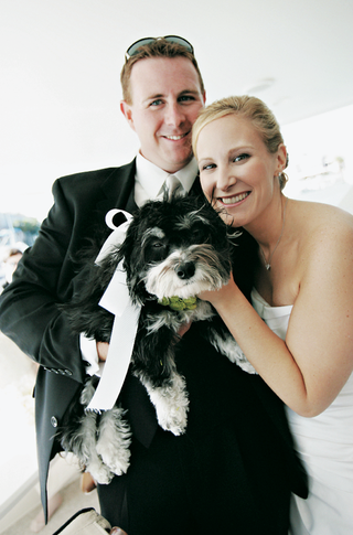 black-and-white-puppy-with-couple