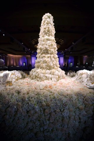 roses-and-orchids-covering-tall-wedding-cake