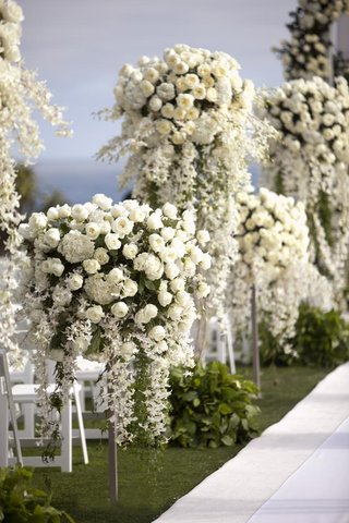 white-roses-and-hydrangeas-on-iron-stands