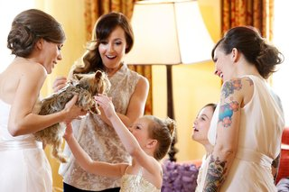 ashley-hebert-and-bridal-party-playing-with-yorkie