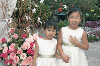 flower-girls-in-white-dresses-and-green-sashes