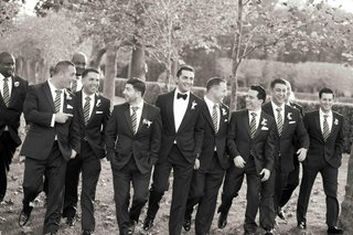 black-and-white-photo-of-men-in-tuxedos-and-ties