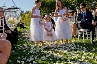 three-flower-girls-walk-down-flower-petal-aisle