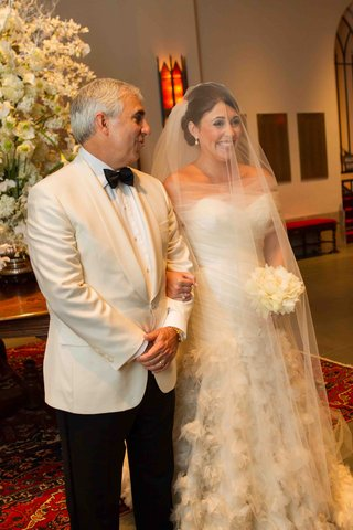 bride-smiles-largely-with-father-of-the-bride