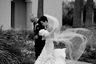 black-and-white-photo-of-bridal-veil-in-wind
