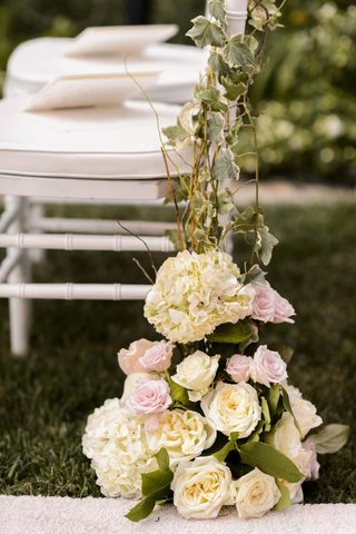 white-ceremony-chair-entwined-with-vines-and-flowers