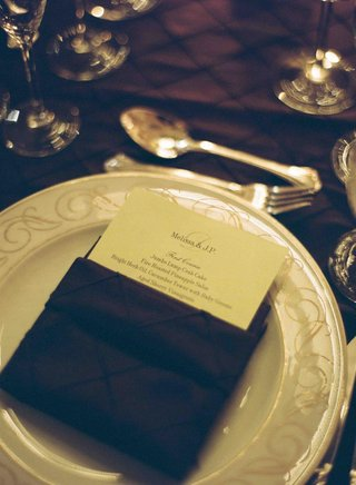 menu-card-tucked-into-dark-textured-napkin
