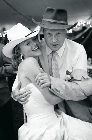 black-and-white-photo-of-bride-and-father-of-bride-in-cowboy-hats