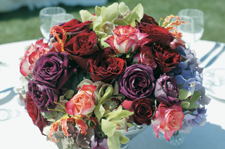 reception-centerpiece-with-red-purple-and-pink-roses