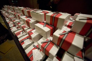 white-favor-boxes-with-red-and-black-ribbon-bows