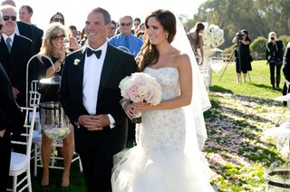 bride-and-father-of-bride-walk-down-pink-petal-aisleway