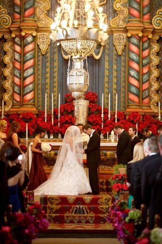 bride-and-groom-at-colorful-catholic-church-wedding