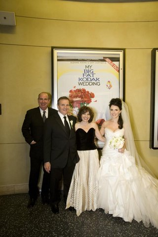 bride-and-groom-with-family-in-front-of-movie-poster