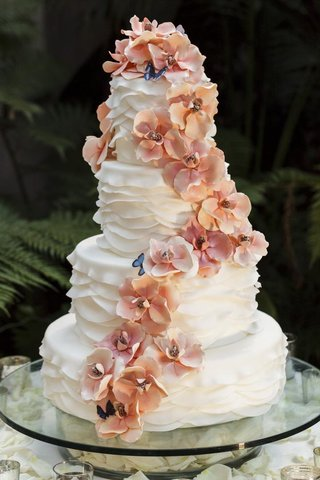 ruffled-wedding-cake-with-sugar-flowers-and-butterflies