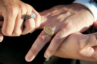 bride-and-grooms-hands-wearing-wedding-rings
