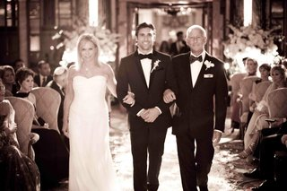 unsaturated-photo-of-groom-walking-down-aisle-with-mom-and-dad