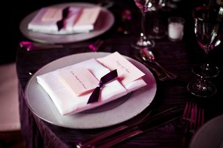 silver-plate-with-pink-name-card-and-purple-ribbon-and-tablecloth