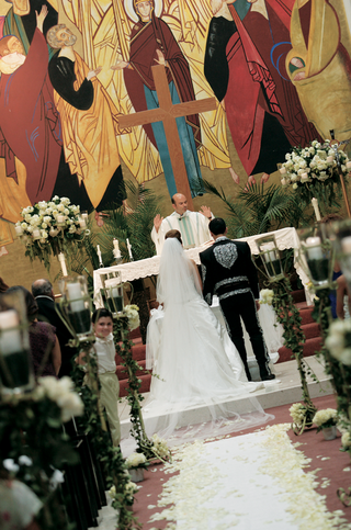 couple-married-in-colorful-church-with-rose-petals