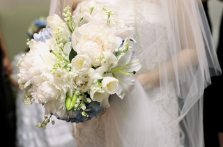 bride-carrying-textured-bridal-bouquet