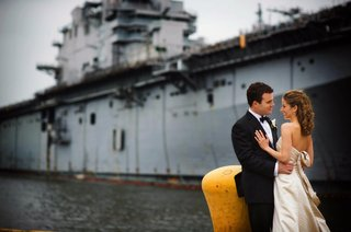 bride-in-a-monique-lhuillier-gown-and-groom-in-a-black-tuxedo-at-the-former-philadelphia-navy-yard