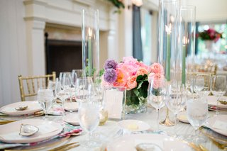 wedding-reception-low-centerpiece-light-green-taper-candles-purple-allium-and-pink-rose-peony-flower