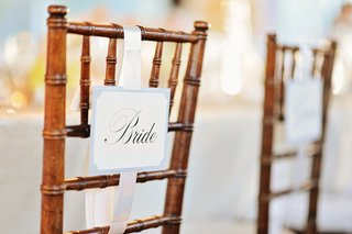 wooden-chairs-with-bride-and-groom-seat-signs