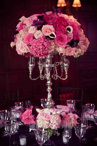 silver-candleholder-with-pink-and-purple-wedding-flowers
