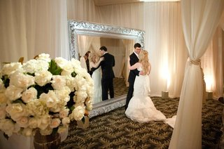 bride-and-groom-dance-in-front-of-mirror-at-wedding-reception