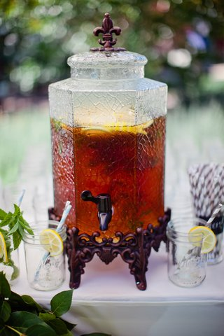 wrought-iron-fleur-de-lis-stand-filled-with-cold-tea