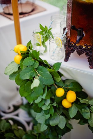 fresh-lemons-and-lemon-leaf-on-white-table