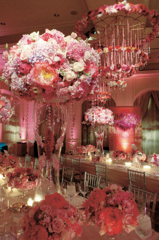 tall-and-short-arrangements-of-pink-flowers-in-pink-reception-room