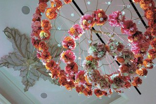 pink-and-orange-flower-rings-hung-from-ceiling