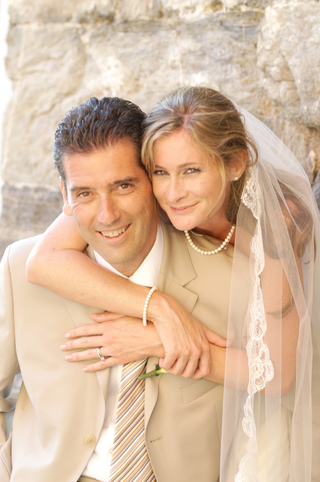 groom-in-khaki-suit-with-bride-in-vernazza-italy