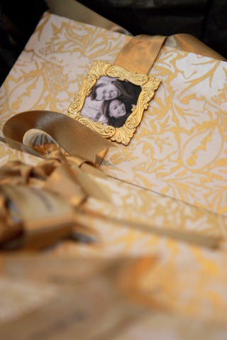 gold-wedding-program-with-framed-photo-of-couple