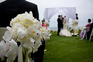 oceanfront-ceremony-with-chuppah-and-flowers