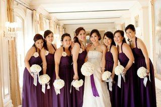bride-with-bridesmaids-in-plum-gowns-and-white-bouquets