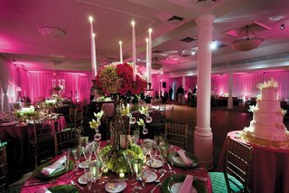 pink-lighting-and-linens-with-green-and-pink-flowers-and-white-candles