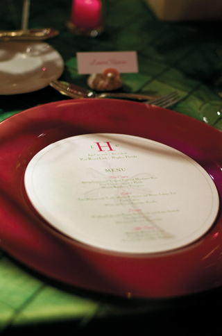 circle-shaped-menu-with-green-and-pink-lettering-on-red-charger